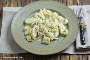 Chicken Alfredo Tortellini recipe in a slow cooker via easycrockpotrecipe.com